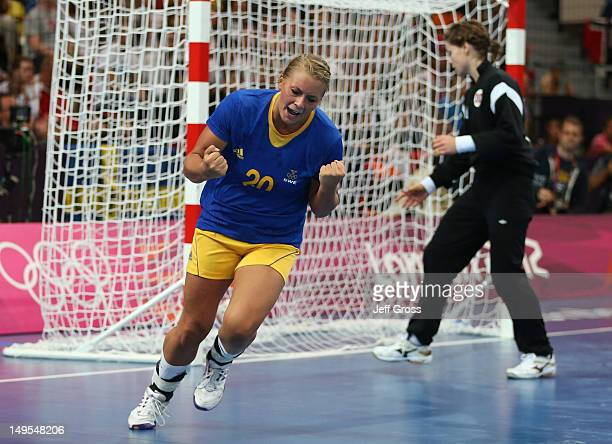 Isabelle Gullden of Sweden celebrates scoring in the first half during the Women's Handball Preliminaries Group B - Match 12 between Sweden and...
