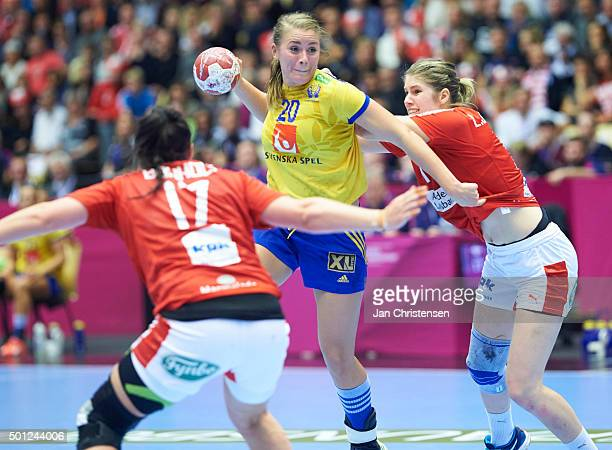 Isabelle Gulldén of Sweden challenge for the ball during the 22nd IHF Women's Handball World Championship Eight Final match between Denmark and...