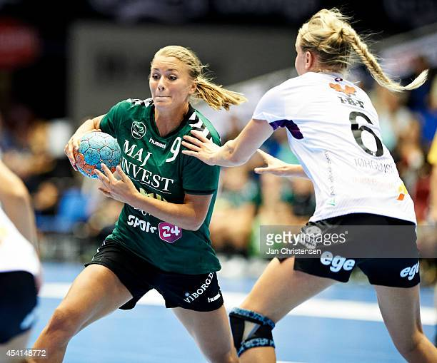 Isabelle Gulldén of Viborg HK challenge for the ball during the Super Cup Final between Viborg HK and FC Midtjylland in Gigantium on August 22 2014...