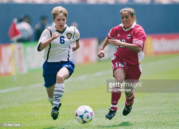 Isabelle Harvey, Forward for Canada challenges Galina Komarova, Defender for Russia during their Group C match of the FIFA Women's World Cup on 26th...