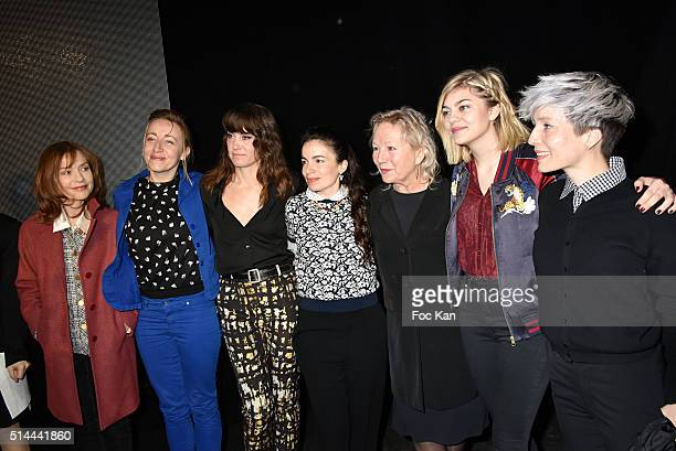 Isabelle Huppert a guest Phoebe Killdeer a guest Agnes B and Louane Emeraattend the Agnes B show as part of the Paris Fashion Week Womenswear...