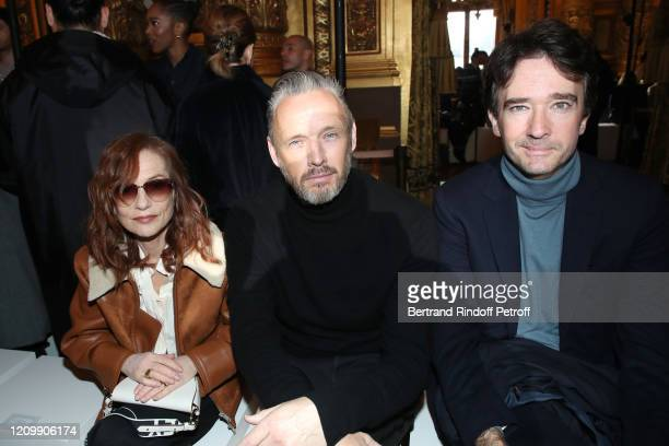 Isabelle Huppert Alasdhair Willis and Antoine Arnault attend the Stella McCartney show as part of the Paris Fashion Week Womenswear Fall/Winter...