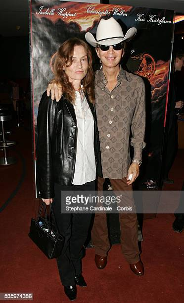 Isabelle Huppert and American director of Heaven's Gate Michael Cimino attend a screening of the movie at the 2005 Paris Film Festival