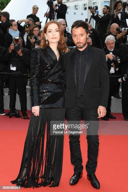 Isabelle Huppert and Anthony Vaccarello attend the screening of Sink Or Swim during the 71st annual Cannes Film Festival at Palais des Festivals on...