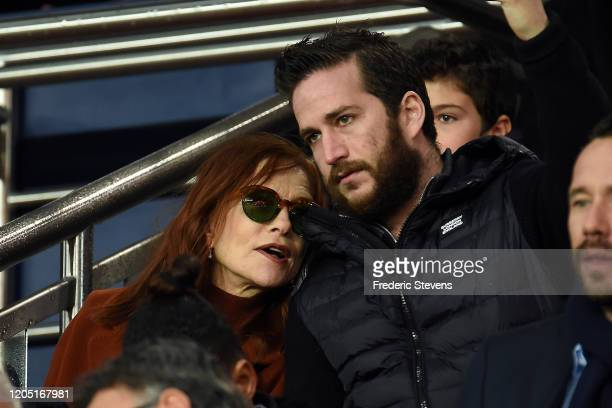 Isabelle Huppert and her son Lorenzo Chammah attend the Ligue 1 match between Paris SaintGermain and Olympique Lyon at Parc des Princes on February...