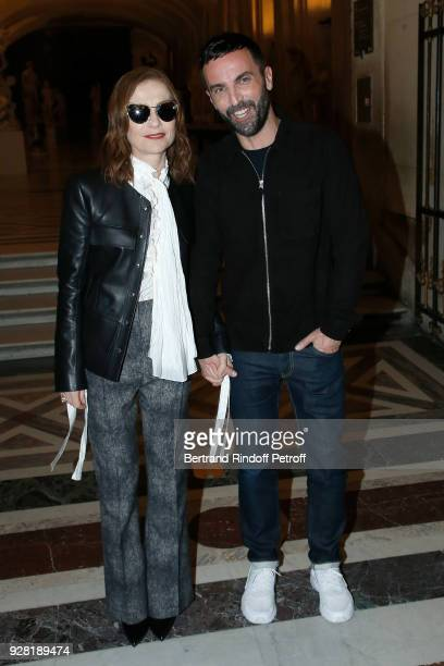 Isabelle Huppert and Stylist Nicolas Ghesquiere pose after the Louis Vuitton show as part of the Paris Fashion Week Womenswear Fall/Winter 2018/2019...