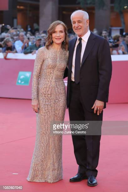 Isabelle Huppert and Toni Servillo walk a red carpet during the 13th Rome Film Fest at Auditorium Parco Della Musica on October 20 2018 in Rome Italy