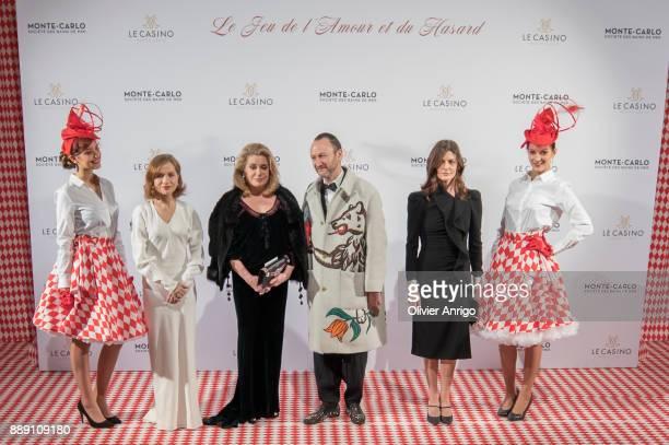 Isabelle Huppert Catherine Deneuve Belgian artist and designer Charles Kaisin and Chiara Mastroianni attends 'Surrealist Dinner Charles Kaisin' at...