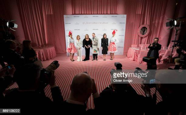 Isabelle Huppert Catherine Deneuve Belgian artist and designer Charles Kaisin and Chiara Mastroianni attends 'Surrealist Dinner Charles Kaisin' at...