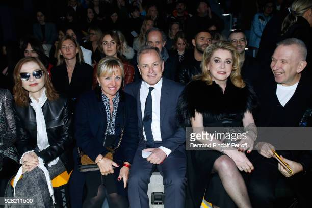 Isabelle Huppert CEO of Louis Vuitton Michael Burke with his wife Brigitte Burke Catherine Deneuve and JeanPaul Gaultier attend the Louis Vuitton...