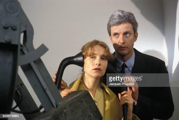 Isabelle Huppert et Mathieu Carrière lors du tournage du film 'Malina' de Werner Schroeter le 8 août 1990 en Autriche