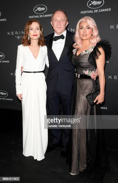 Isabelle Huppert, Francois-Henri Pinault and Salma Hayek attend the Women in Motion Awards Dinner at the 70th Cannes Film Festival at Place de la...