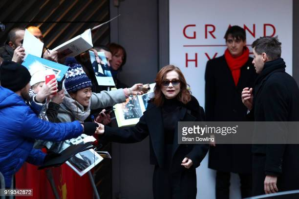 Isabelle Huppert signs autographs for fans when arriving for the 'Eva' photo call during the 68th Berlinale International Film Festival Berlin at...