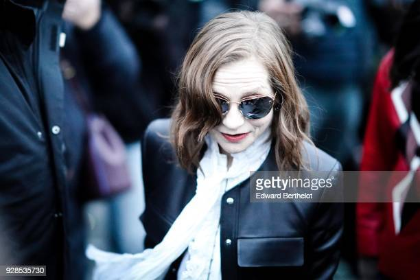 Isabelle Huppert wears sunglasses outside Louis Vuitton during Paris Fashion Week Womenswear Fall/Winter 2018/2019 on March 6 2018 in Paris France