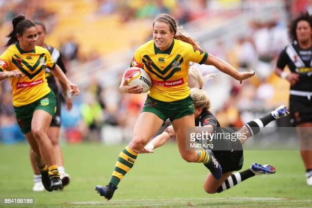Isabelle Kelly of Australia beats the defence to score a try during the 2017 Rugby League Women's World Cup Final between Australia and New Zealand...