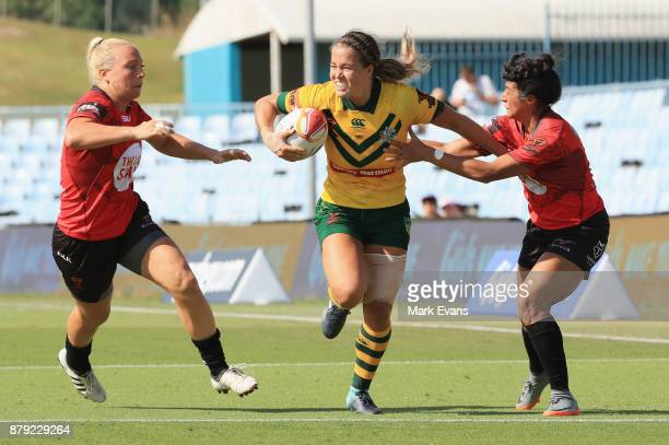 Isabelle Kelly of Australia runs with the ball during the 2017 Rugby League World Cup Semi Final match between XXXX and XXXX at Southern Cross Group...