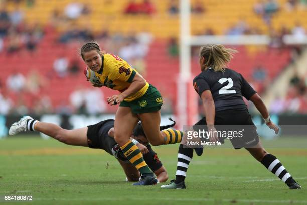 Isabelle Kelly of the Jillaroos is tackled during the 2017 Rugby League Women's World Cup Final between Australia and New Zealand at Suncorp Stadium...