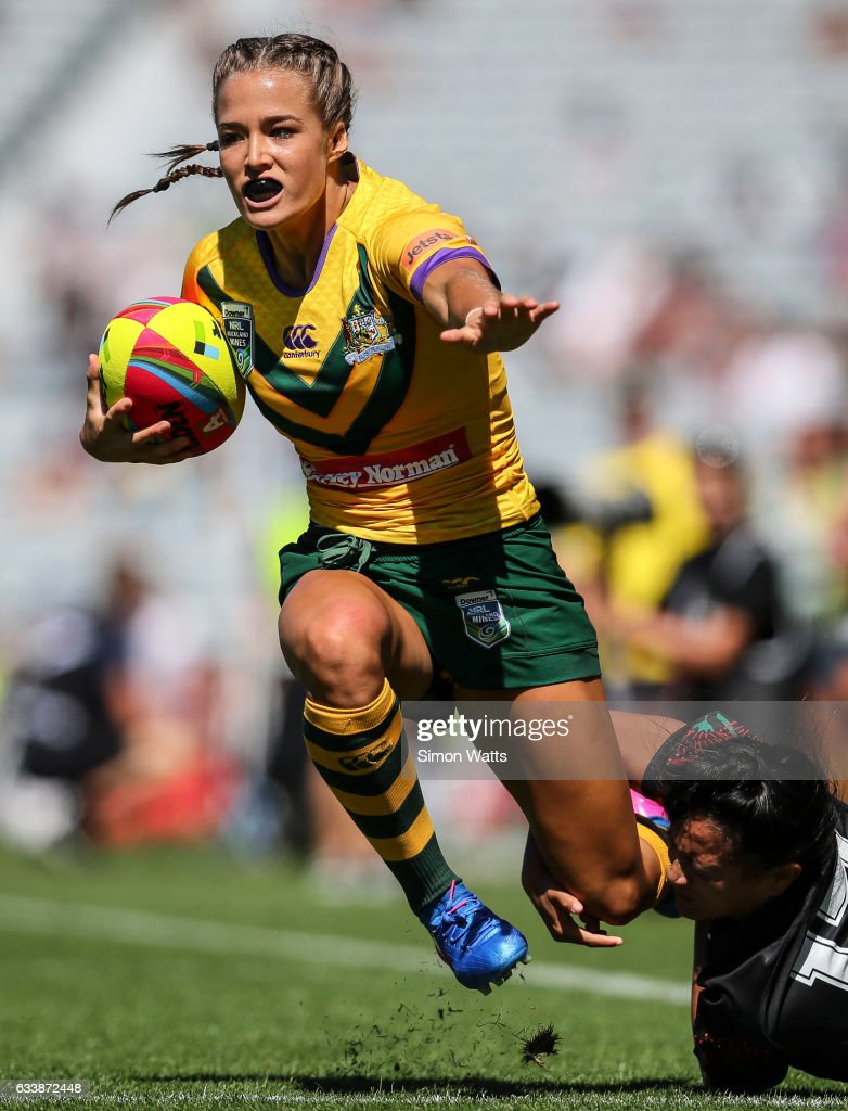 Isabelle Kelly of the Jillaroos looks to beat the tackle of Alexandra Cook of the Kiwi Ferns during the 2017 Auckland Nines match between the Australian Jillaroos and the Kiwi Ferns at Eden Park on February 5, 2017 in Auckland, New Zealand.