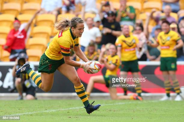 Isabelle Kelly of the Jillaroos scores a try during the 2017 Rugby League Women's World Cup Final between Australia and New Zealand at Suncorp...