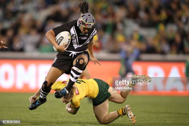 Isabelle Kelly of the Kiwi Ferns evades the tackle of Karina Brown of the Jillaroos during the women's ANZAC Test match between the Australian...