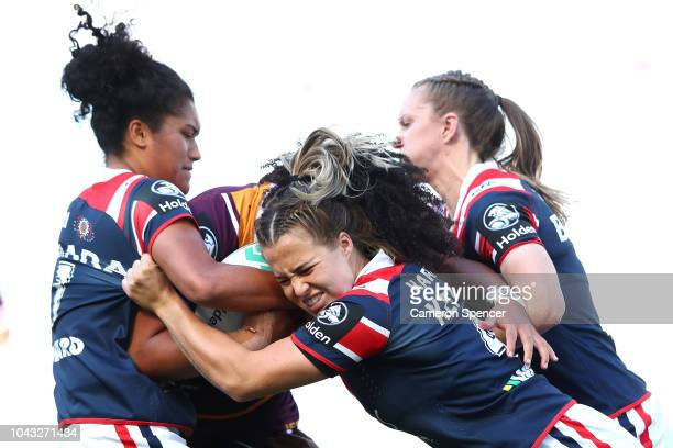 Isabelle Kelly of the Roosters and team mates make a tackle during the 2018 NRL Women's Premiership Grand Final match between the Sydney Roosters and...