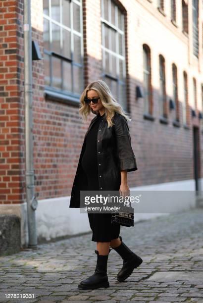 Isabelle Schroeder wearing Dior mini bag, Bottega Veneta boots, Ganni leather jacket, Anine Bing shades and Arket dress on October 01, 2020 in...