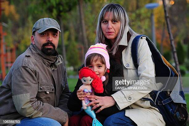 Isabelle Wesselingh Magda Andreescu her husband Sorin and their fouryearold daughter Diana pose in a park in Bucharest on October 28 2010 After more...