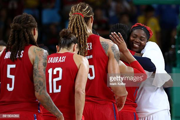Isabelle Yacoubou of France congratulates members of the United States after they defeated France 8667 in a Women's Semifinal Basketball game on Day...