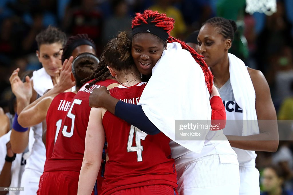 Isabelle Yacoubou #4 of France embraces Lindsay Whalen #4 of the United States after the United States defeated France 86-67 in a Women's Semifinal Basketball game on Day 13 of the Rio 2016 Olympic Games at Carioca Arena 1 on August 18, 2016 in Rio de Janeiro, Brazil.