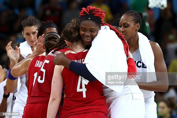 Isabelle Yacoubou of France embraces Lindsay Whalen of the United States after the United States defeated France 8667 in a Women's Semifinal...