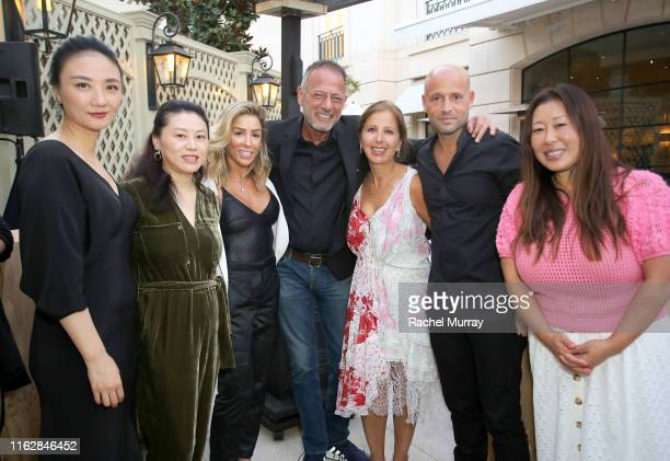 Isabelle Zhuang Ilana KugelGerard Guez Karine Ohana Marcelo Kugel and Susie Wang attend the Ohana Co LA Summer Party at the Peninsula Hotel on August...