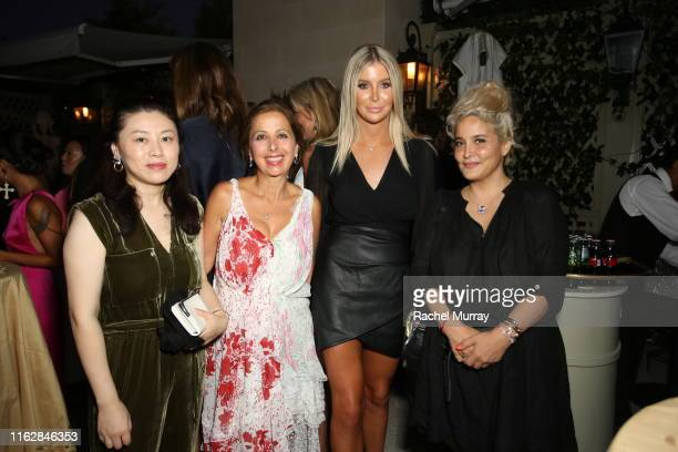 Isabelle Zhuang Karine Ohana Sophia Hutchins and Sarah Lotti attend the Ohana Co LA Summer Party at the Peninsula Hotel on August 19 2019 in Beverly...