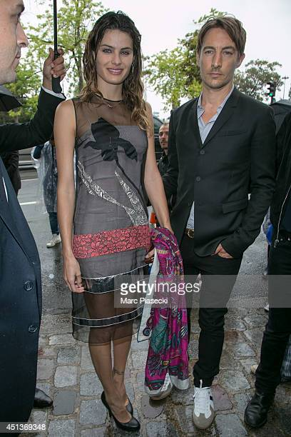 Isabelli Fontana and Benn Northover arrive to attend the DIOR Menswear Spring/Summer 2015 fashion show on June 28 2014 in Paris France