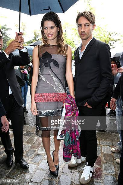 Isabelli Fontana and Benn Northover arrive to attend the DIOR Menswear Spring/Summer 2015 on June 28 2014 in Paris France