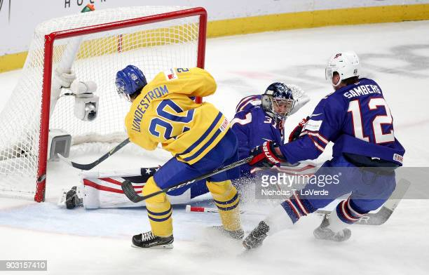Isac Lundeström of Sweden shoots the puck just wide of the net after skating past Dylan Samberg and Joseph Woll of United States during the second...