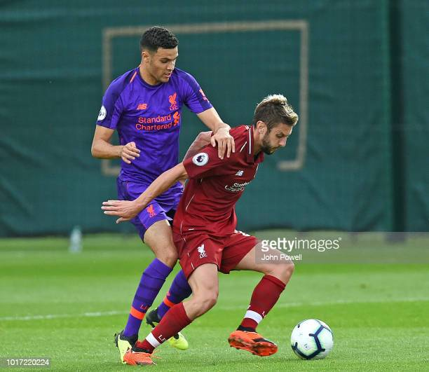 Isaca ChristieDavis and Adam Lallana of Liverpool fight for the ball during a training session at Melwood Training Ground on August 15 2018 in...