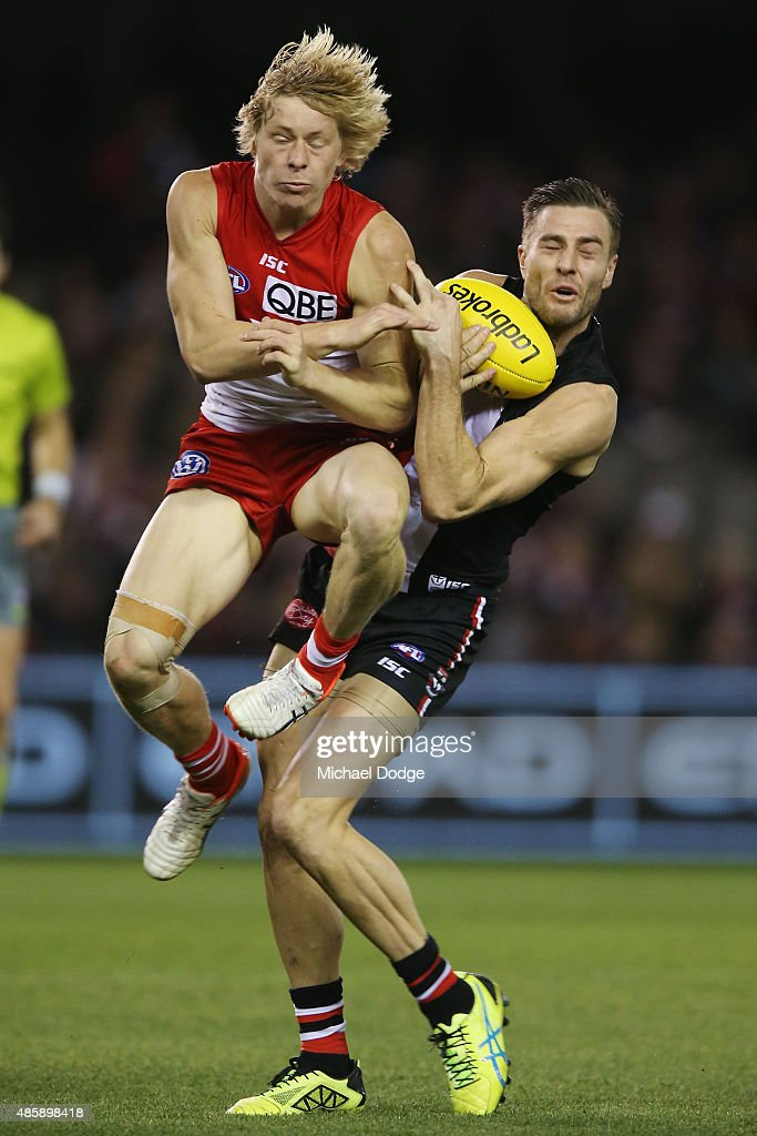 Isacc Heeney of the Swans collides into Sam Fisher of the Saints during the round 22 AFL match between the St Kilda Saints and the Sydney Swans at Etihad Stadium on August 30, 2015 in Melbourne, Australia.