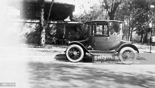 Isadora Wilber in electric car on Woodlawn Avenue with Robie West Porch in background Chicago Illinois 1925