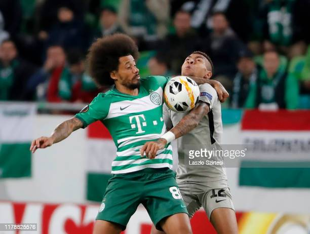 Isael da Silva Barbosa of Ferencvarosi TC fights for the ball with Anicet Abel of PFC Ludogorets 1945 during the UEFA Europa League Group Stage match...
