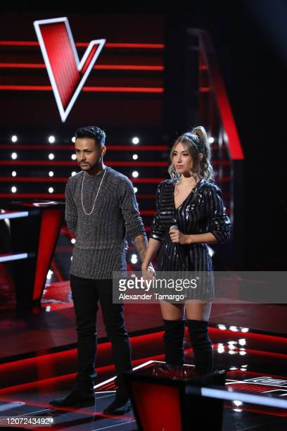Isai Reyes and Michelle Rivera are seen performing on stage during Telemundo's La Voz Batallas Round 2 at Cisneros Studios on March 15 2020 in Miami...