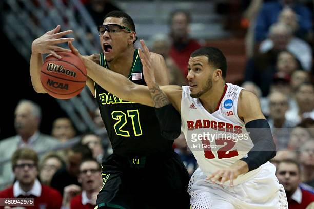 Isaiah Austin of the Baylor Bears and Traevon Jackson of the Wisconsin Badgers go after the ball in the first half during the regional semifinal of...