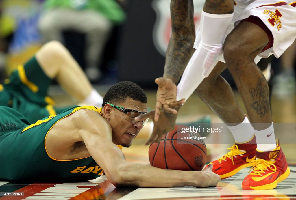 Isaiah Austin #21 of the Baylor Bears dives for a loose ball during the Big 12 Basketball Tournament final game against the Iowa State Cyclones at the Sprint Center on March 15, 2014 in Kansas City, Missouri.