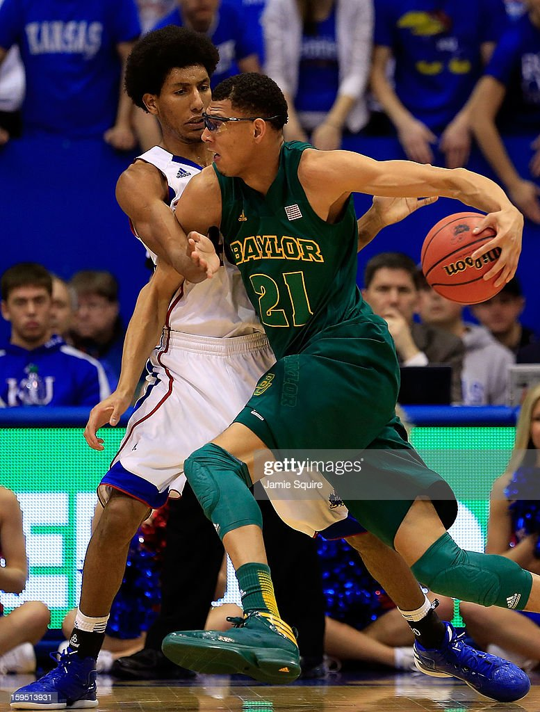 Isaiah Austin #21 of the Baylor Bears drives as Kevin Young #40 of the Kansas Jayhawks defends during the game at Allen Fieldhouse on January 14, 2013 in Lawrence, Kansas.