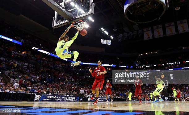 Isaiah Austin of the Baylor Bears dunks in the second half against the Nebraska Cornhuskers during the second round of the 2014 NCAA Men's Basketball...
