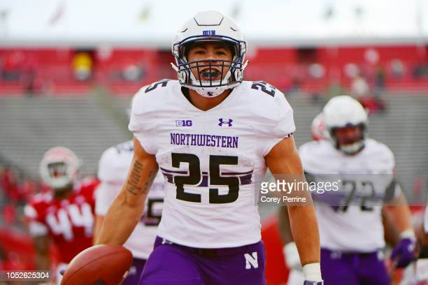 Isaiah Bowser of the Northwestern Wildcats reacts to scoring a touchdown during the fourth quarter against the Rutgers Scarlet Knights on October 20,...