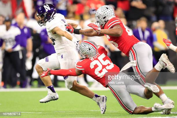 Isaiah Bowser of the Northwestern Wildcats runs the ball in the game against the Ohio State Buckeyes in the third quarter at Lucas Oil Stadium on...