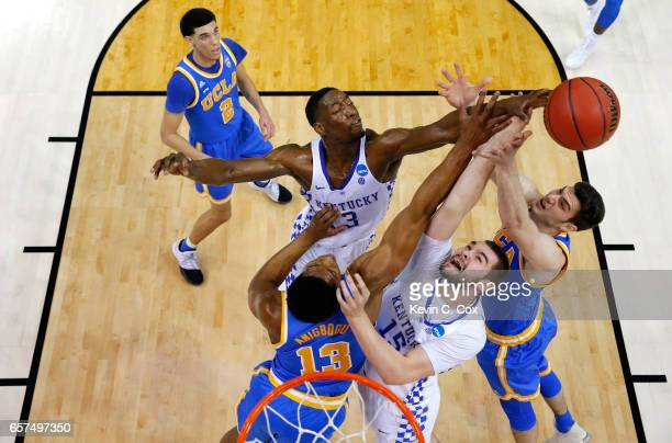 Isaiah Briscoe and Isaac Humphries of the Kentucky Wildcats compete for the ball with Ike Anigbogu and Gyorgy Goloman of the UCLA Bruins in the first...