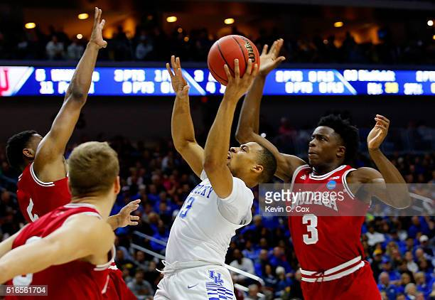 Isaiah Briscoe of the Kentucky Wildcats goes up against Troy Williams and OG Anunoby of the Indiana Hoosiers in the first half during the second...