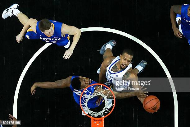 Isaiah Briscoe of the Kentucky Wildcats puts up a layup over Jamall Robinson of the Hofstra Pride in the second half of the Brooklyn Hoops Winter...