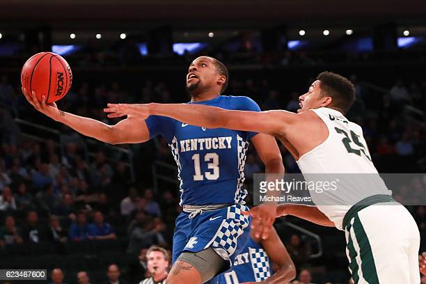 Isaiah Briscoe of the Kentucky Wildcats puts up a shot against Kenny Goins of the Michigan State Spartans in the first half during the State Farm...